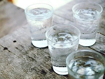 glass of water on table, protea wellness, importance of water
